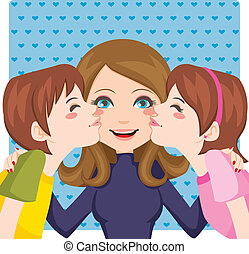 Kissing Mom - Son and daughter kissing happy mother cheeks...