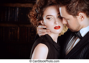 kissing - Close-up portrait of a beautiful man and woman in...