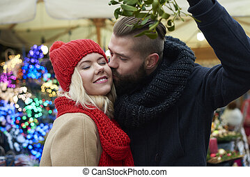 Kissing under the mistletoe is a tradition