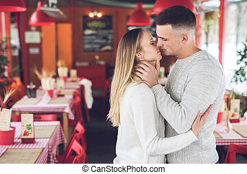Kissing young couple on a date