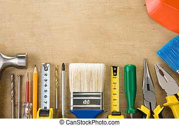 kit of construction tools on wood