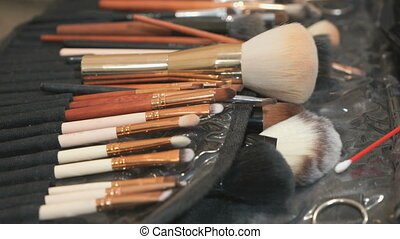 Kit of different brushes for make-up on the table