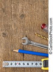 kit of tools on wood background