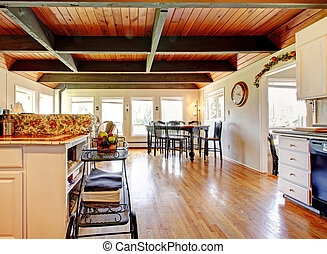 Kitchen and dining room area with wood ceiling.