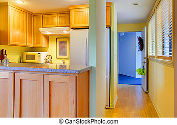 Kitchen and hallway with open door
