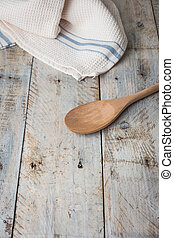 Kitchen background with towel and cooking tools top view copy space.