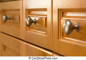 Kitchen Cabinet Drawers - Full frame of a row of kitchen...