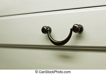 Kitchen cabinet handles. White colored wood