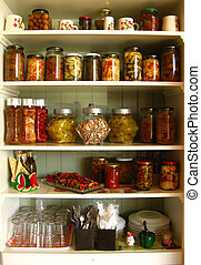 Kitchen cabinet - A white kitchen cabinet full of jars,...