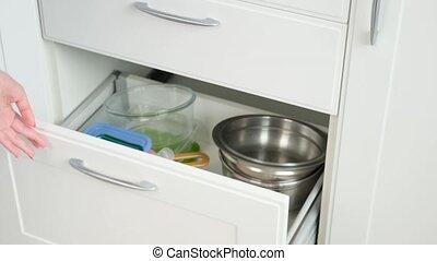 kitchen cabinet, woman close cupboard door - kitchen...