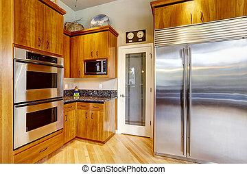 Kitchen cabinets and steel appliances - Kitchen corner in ...
