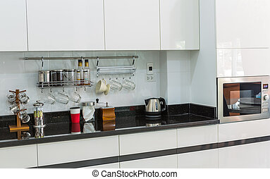 Kitchen cabinets with coffee corner in modern home living...