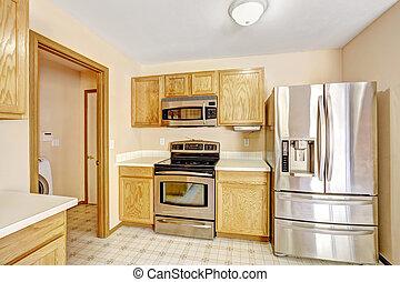 Kitchen cabinets with steel appliances - Wooden kitchen ...