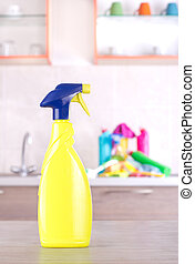 Kitchen cleaning concept - Spray bottle on table with bunch...