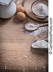 kitchen composition eggs milk flour and tools