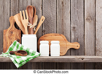 Kitchen cooking utensils on shelf