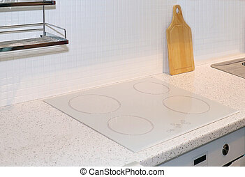 Kitchen cooktop detail - Electric white glass cook top...