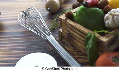 Kitchen corolla, pizza knife, herbs, vegetables pepper,...