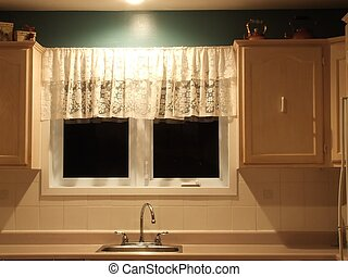 kitchen counter with sink and window