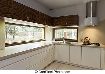 Kitchen counter top - Long beige counter top in modern...