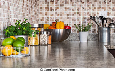 Kitchen countertop with food ingredients and herbs - Modern...