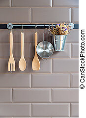 Kitchen decoration with wooden fork and spoon