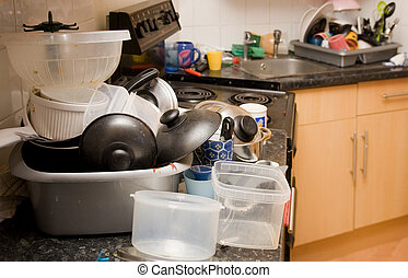 kitchen mess, dirty dishes needing to be washed and piles of washing-up