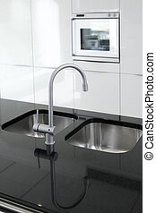 kitchen faucet and oven modern black and white