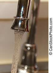 kitchen faucet with running water