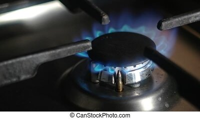 Kitchen gas stove with burning blue natural gas 4k footage