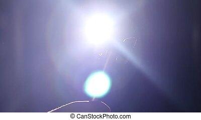 Kitchen hammer beat off under spotlight beams. Slow motion. Agression
