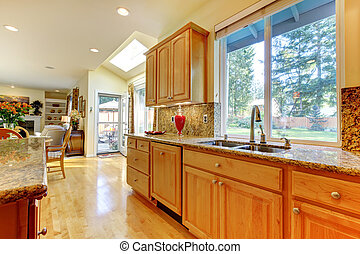Kitchen in golden maple wood  - Bright large open kitchen
