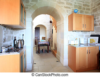 Kitchen in Greek villa - The kitchen and dining room of a...