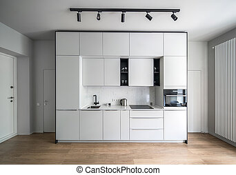 Kitchen in modern style with light walls