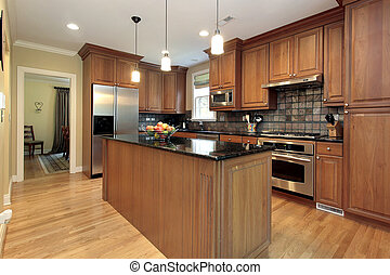 Kitchen in new construction house with marble island