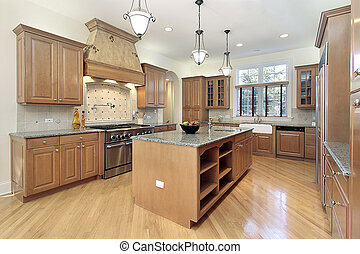 Kitchen in new construction home with oak cabinetry
