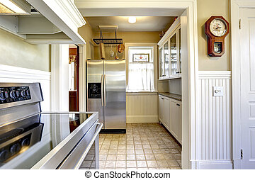 Kitchen interior in old house with modern appliances