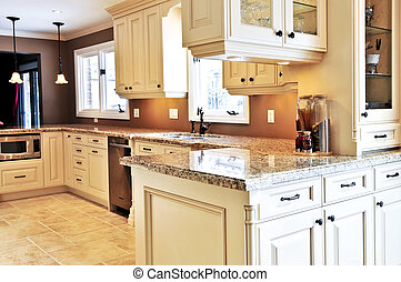 Interior of modern luxury kitchen with granite countertop