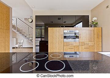 Kitchen interior open to the staircase