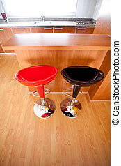 kitchen interior with bar chairs in the apartment