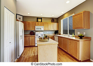 Kitchen interior with brown cabinets, hardwood floor