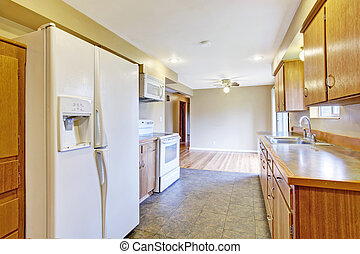 Kitchen interior with dining area in empty house