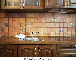 Kitchen Interior With Tiles Wall in Beige