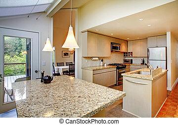 Kitchen interior with walkout deck