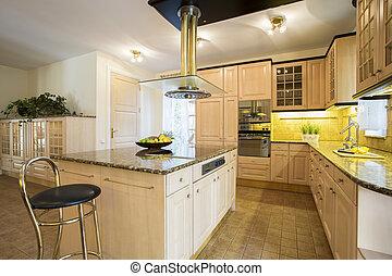 Kitchen island in designed kitchen