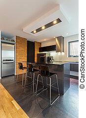 Kitchen island in modern interior - Vertical view of kitchen...