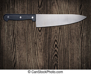 Kitchen knife on wooden table. - Kitchen knife on wooden...