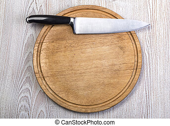 Kitchen knife on wooden table
