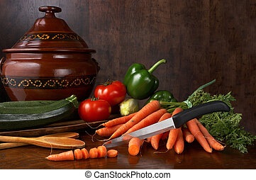 Kitchen knife - Sharp kitchen knif and vegetables on a ...