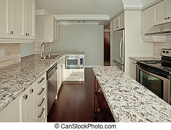 Kitchen - Modern kitchen with marble countertops